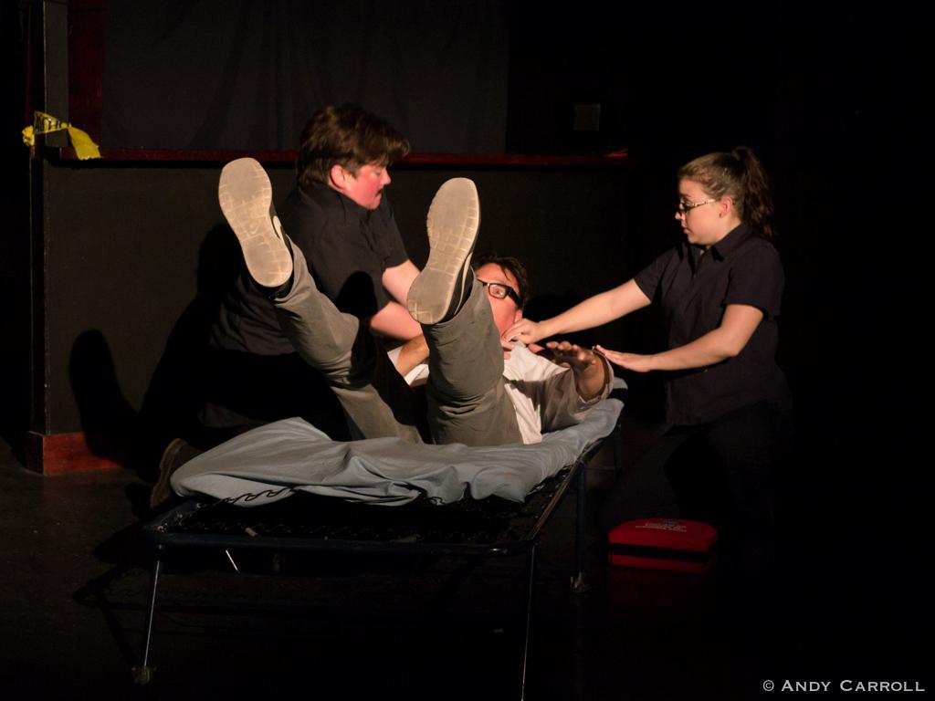 Paramedic 1 (Em Glasspool), Dr. Secare (Cal Coons), and Paramedic 2 (Elizabeth Moody)