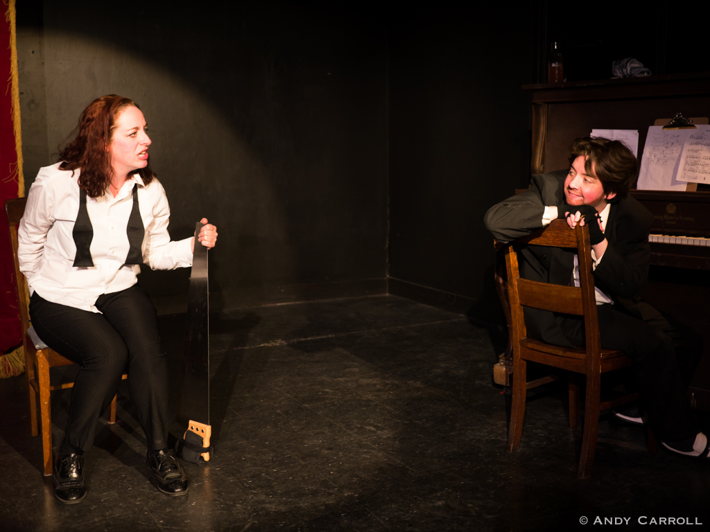 Mel Malarkey (Cathy Petch) with musical saw and Dickie (Em Glasspool)